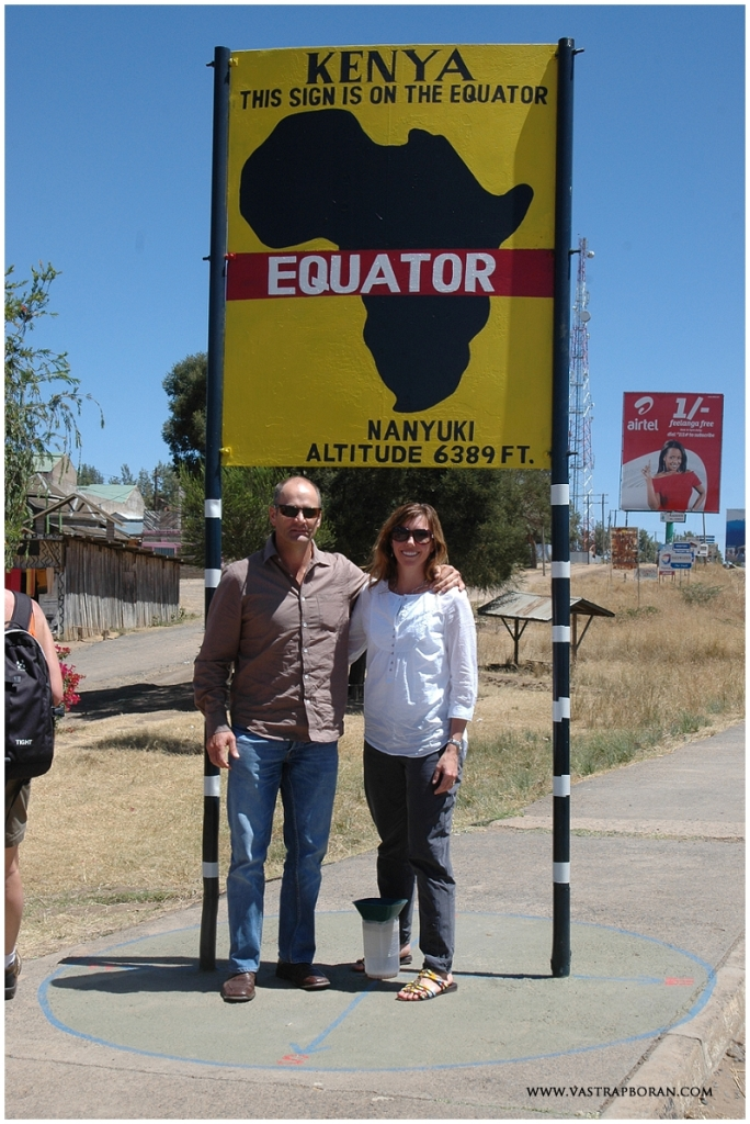 At the equator sign in Nanyuki at the base of Mount Kenya.